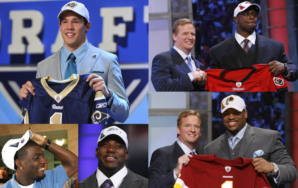 Photo - Oklahoma quarterback Sam Bradford smiles as he holds up a jersey after he was selected as the No. 1 overall pick by the St. Louis Rams in the first round of the NFL Draft at Radio City Music Hall, Thursday, April 22, 2010, in New York.  (AP Photo/Stephen Chernin) ORG XMIT: NYFF130