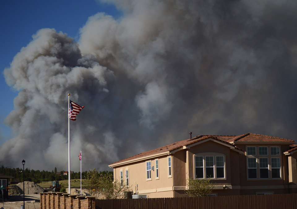 Photo - The Black Forest Fire burns northeast of Colorado Springs, Colo, Tuesday, June 11, 2013. The fire burned several homes and forced the evacuation of thousands of people. (AP Photo/Bryan Oller)