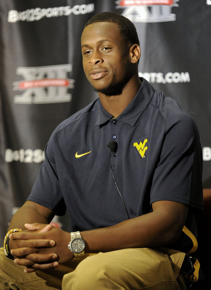 West Virginia quarterback Geno Smith looks on between questions at NCAA college football Big 12 Media Days, Tuesday, July 24, 2012, in Dallas. (AP Photo/Matt Strasen)