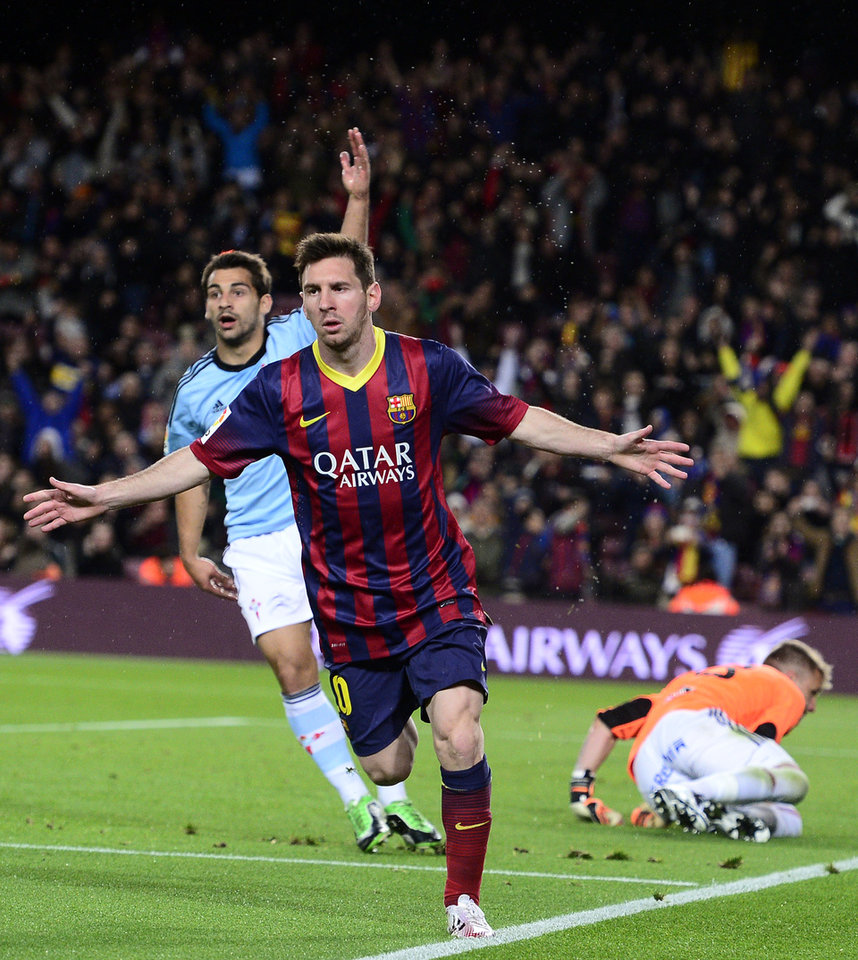 Photo - FC Barcelona's Lionel Messi, from Argentina, reacts after scoring against Celta Vigo during a Spanish La Liga soccer match at the Camp Nou stadium in Barcelona, Spain, Wednesday, March 26, 2014. (AP Photo/Manu Fernandez)