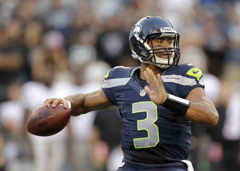 Photo -   Seattle Seahawks quarterback Russell Wilson drops back to pass against the Oakland Raiders in the first half of a preseason NFL football game Thursday, Aug. 30, 2012 in Seattle. The Seahawks won 21-3. (AP Photo/Stephen Brashear)