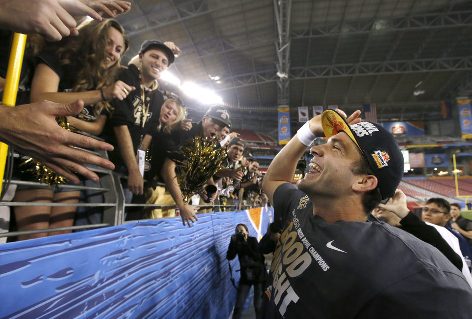 Central Florida\'s Blake Bortles smiles as he celebrates with fans after the Fiesta Bowl NCAA college football game win against Baylor Wednesday, Jan. 1, 2014, in Glendale, Ariz. Central Florida defeated Baylor 52-42. (AP Photo/Ross D. Franklin)