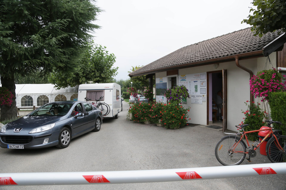 Photo -   A car drives at the entrance of the campground where the slain British family were holidaying in Saint Jorioz, near Annecy, Thursday, Sept. 6, 2012. A 4-year-old British girl hid for eight hours beneath the bodies of slain family members in the back of their car in a nearby forest, before she was discovered by French investigators who had been guarding the vehicle, a prosecutor said Thursday. Three people, a man and two women, had been shot to death, as was a French cyclist whose body was found nearby. (AP Photo/Alexis Moro)