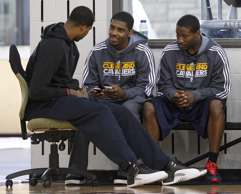 Photo -   With their season ended, Cleveland Cavaliers players, from left, Tristan Thompson, Kyrie Irving, and Donald Sloan talk together at the team's practice facility in Independence, Ohio, on Friday, April 27, 2012. (AP Photo/Amy Sancetta)