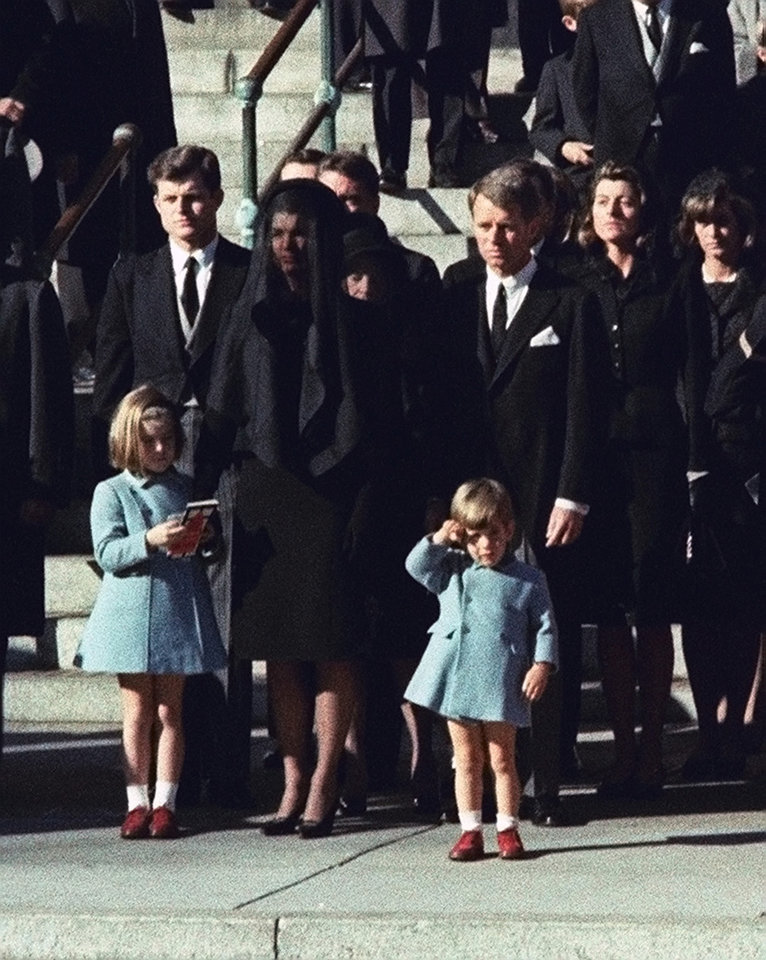 Photo - FILE - This Nov. 25, 1963 file photo shows three-year-old John F. Kennedy Jr. saluting his father's casket in Washington on Nov. 25, 1963, three days after the president was assassinated in Dallas. Widow Jacqueline Kennedy, center, and daughter Caroline Kennedy are accompanied by the late president's brothers Sen. Edward Kennedy, left, and Attorney General Robert Kennedy. Sony Electronics and the Nielsen television research company collaborated on a survey ranking TV's most memorable moments. Other TV events include, the Sept. 11 attacks in 2001, Hurricane Katrina in 2005, the O.J. Simpson murder trial verdict in 1995 and the death of Osama bin Laden in 2011. (AP Photo, file) ORG XMIT: NYET132