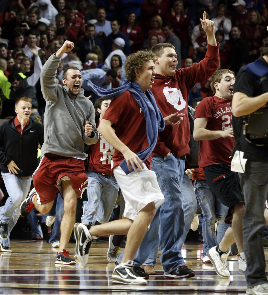 Photo - Fans flood the court as the University of Oklahoma Sooners (OU) defeat the Kansas Jayhawks (KU) 72-66 in NCAA, men's college basketball at The Lloyd Noble Center on Saturday, Feb. 9, 2013 in Norman, Okla. Photo by Steve Sisney, The Oklahoman