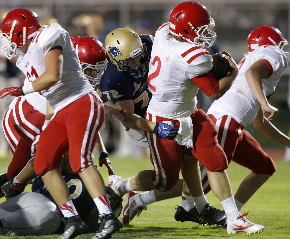 Photo - Braden Ruth of Davis runs past Heritage Hall's Jack Ross for a touchdown during their high school football game in Oklahoma City, Friday, Sept. 20, 2013. Photo by Bryan Terry, The Oklahoman
