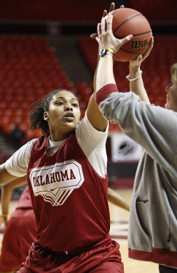 Photo - OU: University of Oklahoma center Abi Olajuwon blocks a shot during NCAA women's college basketball practice, Saturday, March 20, 2010, in Norman, Okla.  Oklahoma plays South Dakota State in a first round game on Sunday.  (AP Photo/Alonzo Adams) ORG XMIT: OKAA111