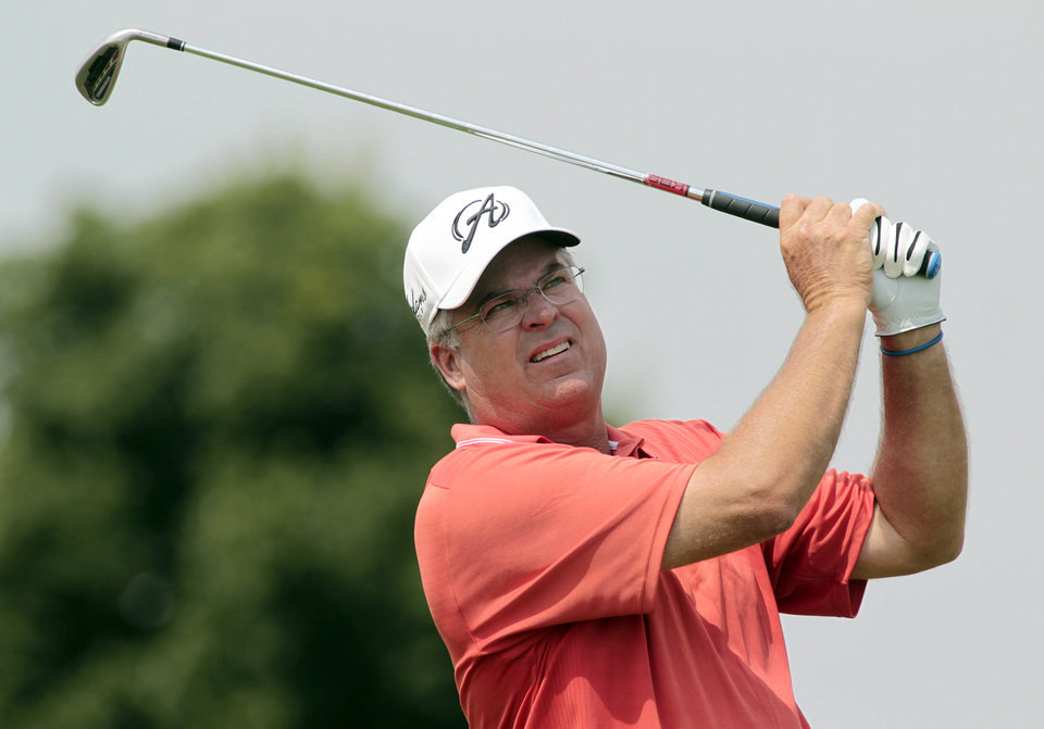 Photo - Kenny Perry hits his drive off the fourth tee during the third round of the Champions Tour 3M Championship golf tournament at TPC Twin Cities in Blaine, Minn., Sunday, Aug. 3, 2014. AP Photo/Paul Battaglia)