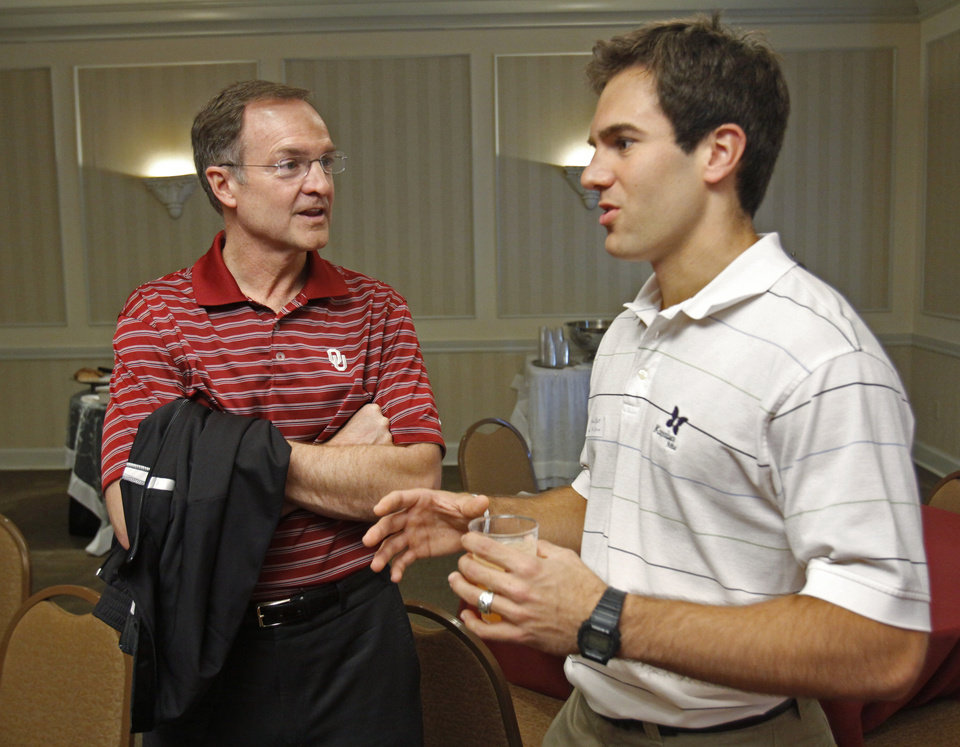 Photo - University of Oklahoma basketball coach Lon Kruger talks with Michael Elliott, a Sigma Phi Epsilon member, as he has lunch with fraternity and sorority members on Thursday, April 28, 2011, in Norman.  Photo by Steve Sisney, The Oklahoman