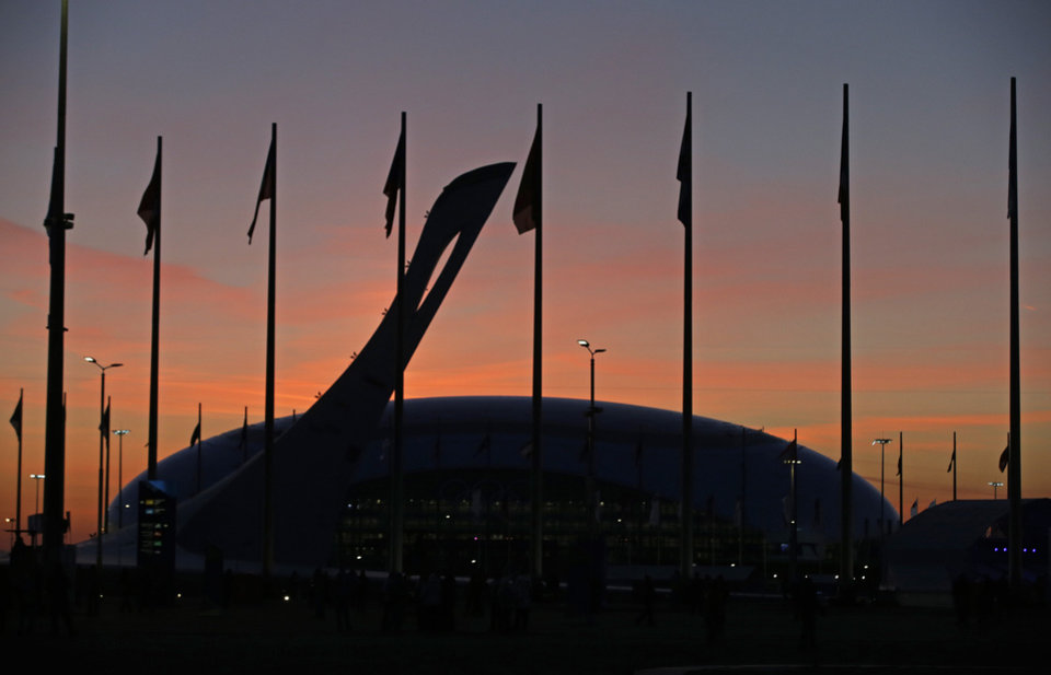 Photo - The Olympic caldron is seen as the sun sets before the opening ceremony of the 2014 Winter Olympics in Sochi, Russia, Friday, Feb. 7, 2014. (AP Photo/Darron Cummings)