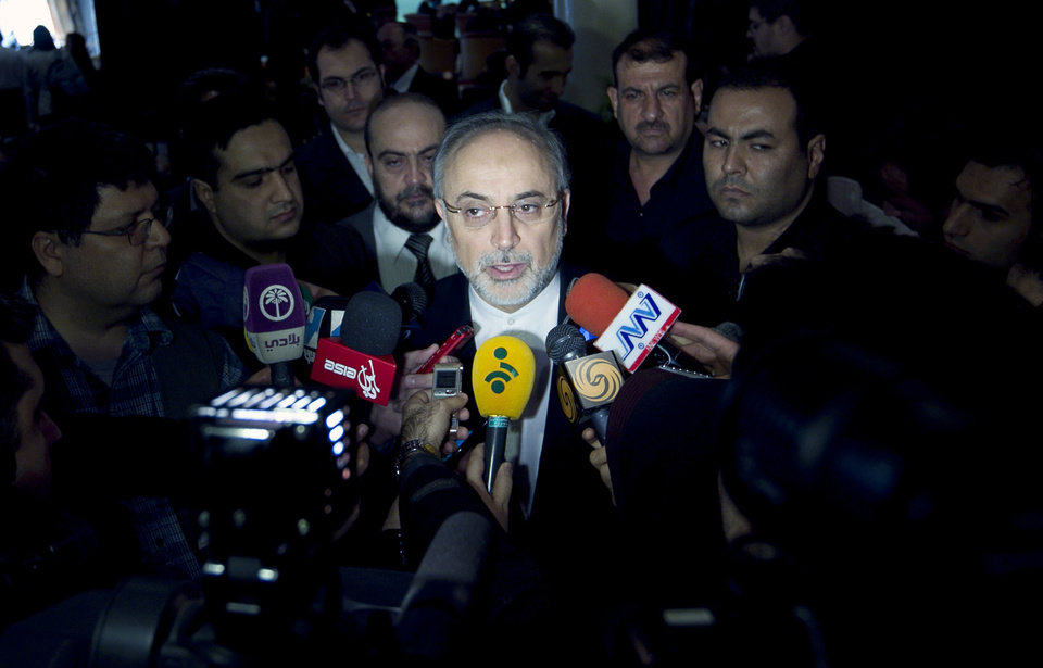 Photo -   Iranian Foreign Minister, Ali Akbar Salehi, center, speaks with media, prior to start the