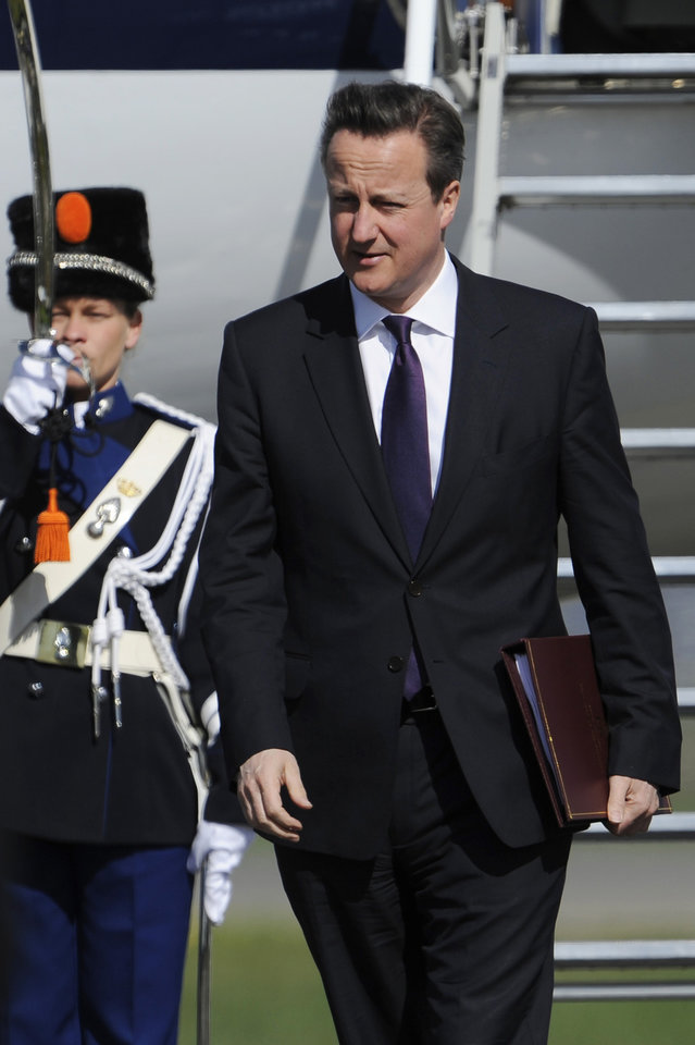 Photo - British Prime Minister David Cameron arrives at Schiphol airport in Amsterdam on Monday March 24, 2014 ahead of the March 24-25 Nuclear Security Summit (NSS) in The Hague. (AP Photo/John Thys, POOL)