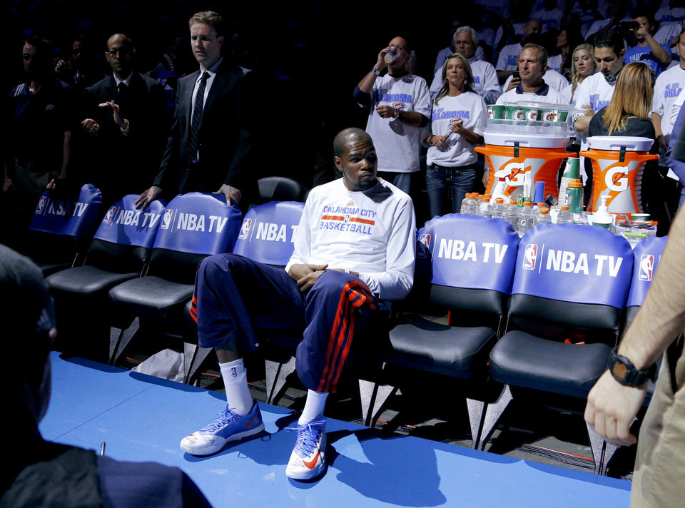Photo - Oklahoma City's Kevin Durant sits on the bench during player introductions before Game 2 of the Western Conference semifinals in the NBA playoffs between the Oklahoma City Thunder and the Los Angeles Clippers at Chesapeake Energy Arena in Oklahoma City, Wednesday, May 7, 2014. Photo by Bryan Terry, The Oklahoman