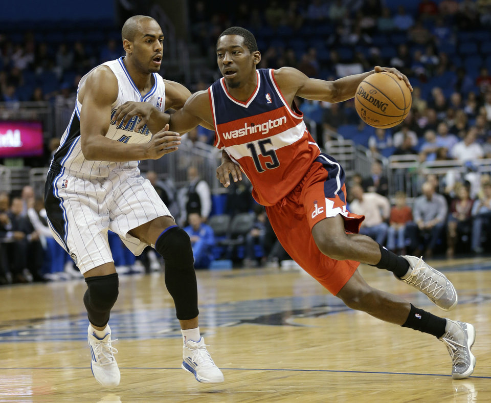 FILE - In this Dec. 19, 2012 file photo, Washington Wizards shooting guard Jordan Crawford (15) drives the ball past Orlando Magic's Arron Afflalo (4) during the first half of an NBA basketball game on in Orlando, Fla. The Wizards have sent disgruntled guard Jordan Crawford to the Boston Celtics for center Jason Collins and injured guard Leandro Barbosa. The Wizards dispensed of Crawford shortly before the Thursday afternoon, Feb. 21, 2013  trade deadline. (AP Photo/John Raoux, File)