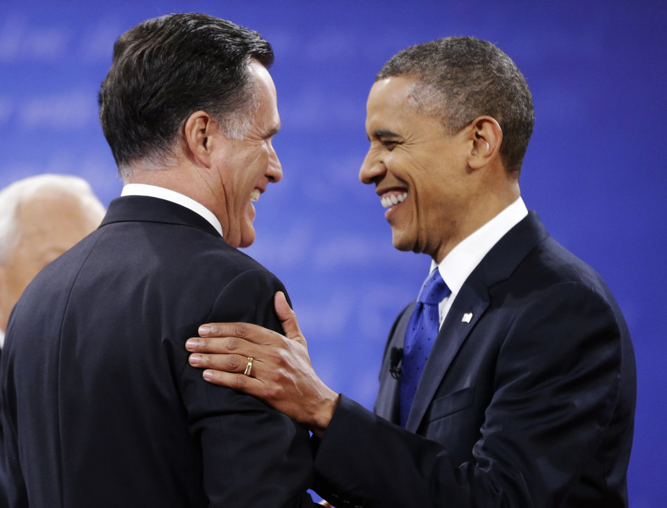 Photo -   Republican presidential nominee Mitt Romney, left is greeted by President Barack Obama before the start of the third presidential debate at Lynn University, Monday, Oct. 22, 2012, in Boca Raton, Fla. (AP Photo/David Goldman)