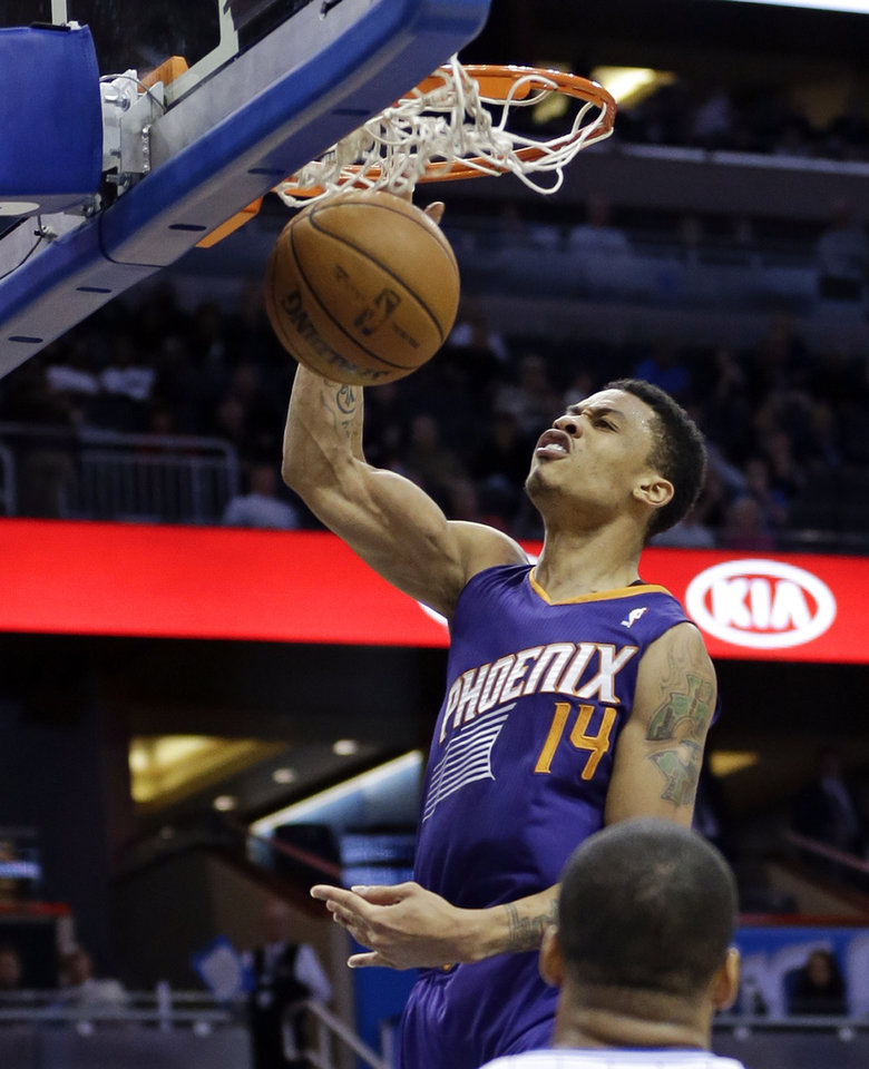 Phoenix Suns' Gerald Green (14) dunks the ball in front of Orlando Magic's Jameer Nelson during the first half of an NBA basketball game in Orlando, Fla., Sunday, Nov. 24, 2013. (AP Photo/John Raoux)