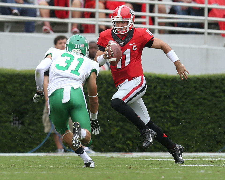 Photo - Georgia quarterback Aaron Murray (11) runs for a first down as North Texas cornerback Kenny Buyers (31) pursues in the first half of an NCAA college football game at Sanford Stadium Saturday, Sept. 21, 2013, in Athens, Ga. (AP Photo/Atlanta Journal-Constitution, Jason Getz )  MARIETTA DAILY OUT; GWINNETT DAILY POST OUT; LOCAL TV OUT; WXIA-TV OUT; WGCL-TV OUT