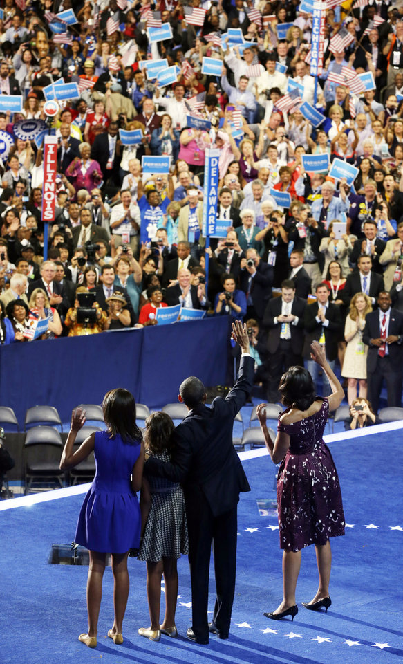 Photo -   President Barack Obama, first lady Michelle Obama, their children Malia and Sasha, wave on stage on the final day of the Democratic National Convention in Charlotte, N.C., Thursday, Sept. 6, 2012. (AP Photo/Pablo Martinez Monsivais)