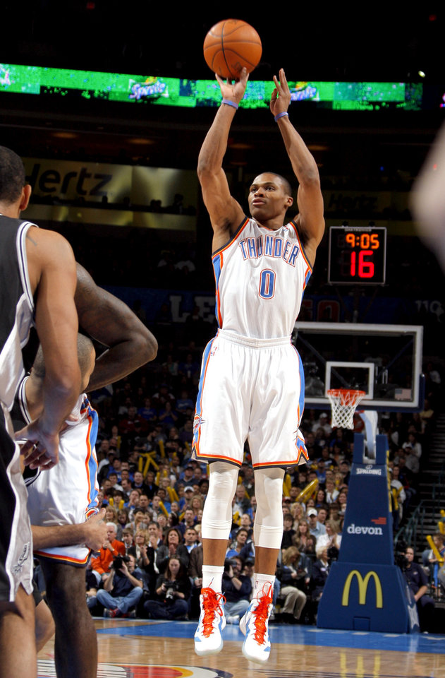 Oklahoma City Thunder\'s Russell Westbrook (0) shoots during the the NBA basketball game between the Oklahoma City Thunder and the San Antonio Spurs at the Chesapeake Energy Arena in Oklahoma City, Sunday, Jan. 8, 2012. Photo by Sarah Phipps, The Oklahoman