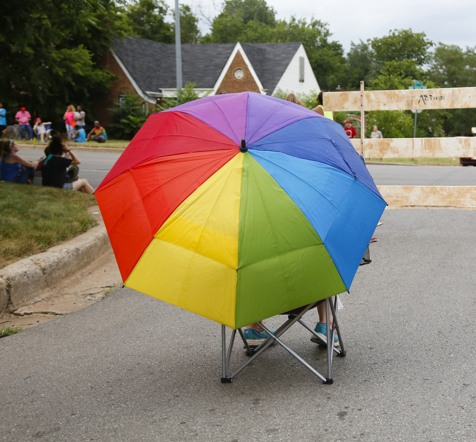Photo - Jordanne Benton holds her rainbow umbrella as she waits for the OKC Pride Parade to begin on NW 39  in Oklahoma City, Sunday, June 26, 2016. Photo by Kurt Steiss, The Oklahoman