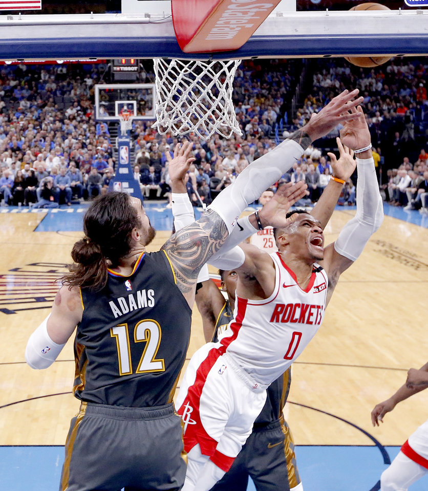Photo - Oklahoma City's Steven Adams (12) and Houston's Russell Westbrook (0) fight for a rebound during the NBA basketball game between the Oklahoma City Thunder and the Houston Rockets at the Chesapeake Energy Arena in Oklahoma City,  Thursday, Jan. 9, 2020.  [Sarah Phipps/The Oklahoman]
