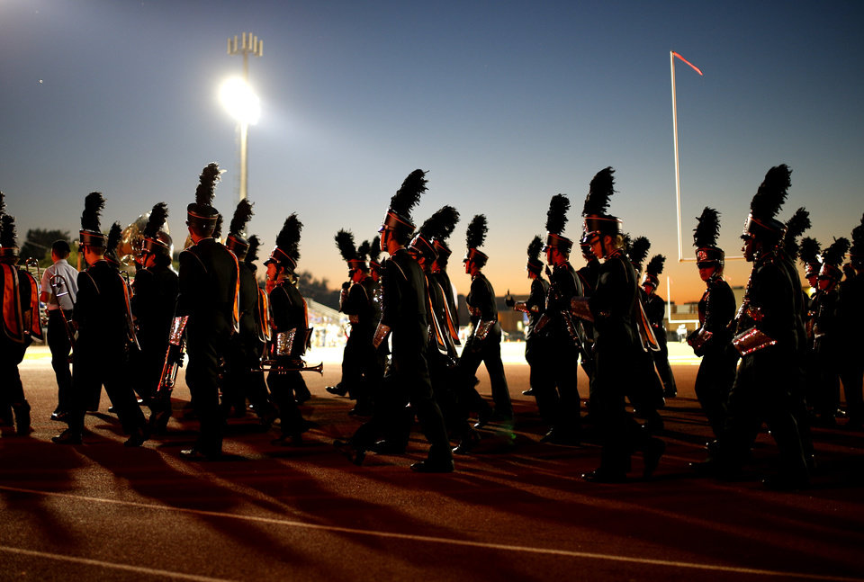 The Putnam City band makes their way to perform during halftime of Putnam City's football game against Sapulpa at Putnam City in Oklahoma City, Thursday, Sept. 26, 2013. Photo by Bryan Terry, The Oklahoman