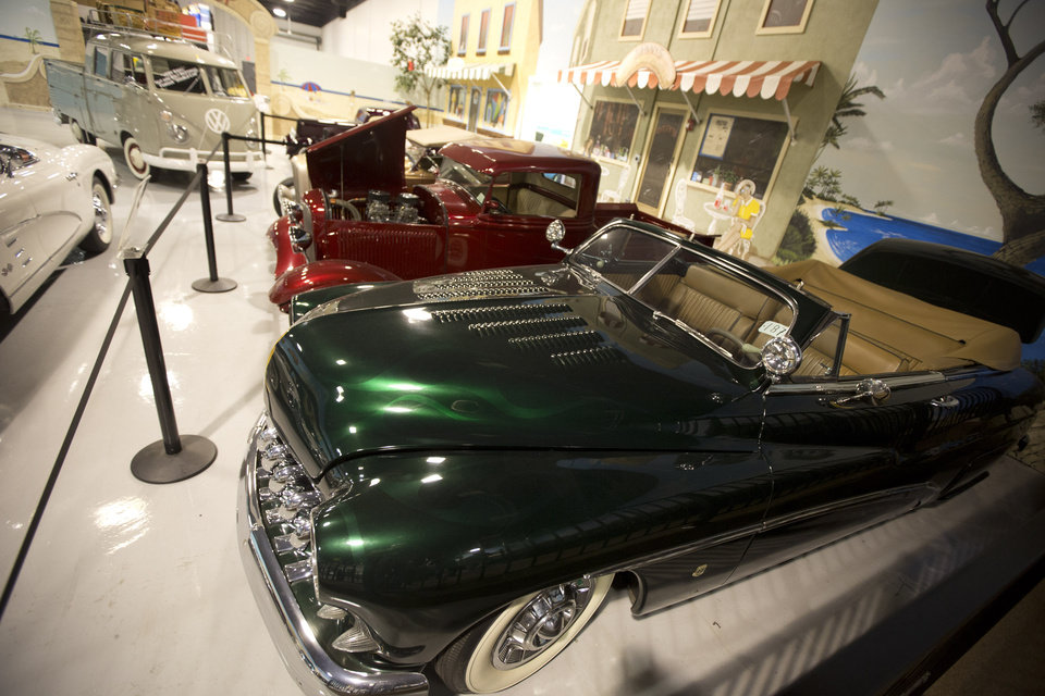 "This Monday, Nov. 26, 2012 photo shows a 1950 Mercury Custom Convertible and other hot rods in a North Palm Beach, Fla. private auto museum. .John Staluppi has spent a lifetime selling cars, so successful in his trade he boasts more than two dozen dealerships and more sales than he ever could count. But even he has never seen a sale like this. Staluppi is liquidating his Cars of Dreams Museum and its 115 collector vehicles in an auction Saturday. The Batmobile, the Evel Knievel motorcycle, the lines and lines of perfectly shined cars, all of them will be gone. ""I'm starting to get sad,"" he admits. (AP Photo/J Pat Carter)"