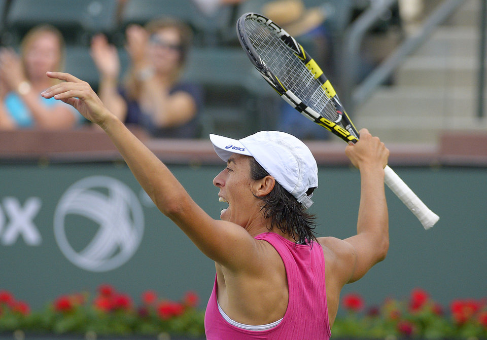 Photo - Francesca Schiavone, of Italy, celebrates after winning a game against Mona Barthel, of Germany, at the BNP Paribas Open tennis tournament, Thursday, March 6, 2014, in Indian Wells, Calif. (AP Photo/Mark J. Terrill)