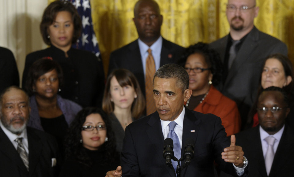 Photo - President Barack Obama speaks about unemployment benefits, Tuesday, Jan. 7, 2014, during an event in the East Room of the White House in Washington. The president applauded a Senate vote advancing legislation to renew jobless benefits for the long-term unemployed as an important step. The Senate voted 60-37 Tuesday to clear the bill's first hurdle. But Republicans who voted to move ahead still want concessions that will have to be worked out before final passage. The Republican-controlled House would also have to vote for it. (AP Photo/Susan Walsh)