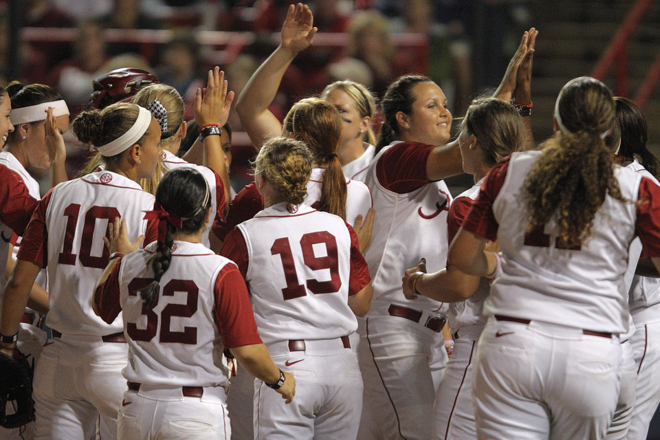 Photo - Alabama celebrates during Game 3 of the Women's College World Series softball championship between OU and Alabama at ASA Hall of Fame Stadium in Oklahoma City, Wednesday, June 6, 2012.  Photo by Garett Fisbeck, The Oklahoman