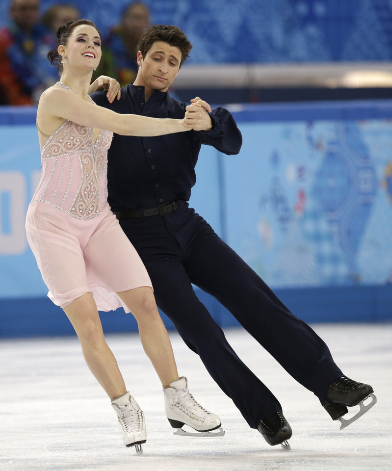 Photo - Tessa Virtue and Scott Moir of Canada compete in the ice dance free dance figure skating finals at the Iceberg Skating Palace during the 2014 Winter Olympics, Monday, Feb. 17, 2014, in Sochi, Russia. (AP Photo/Darron Cummings)
