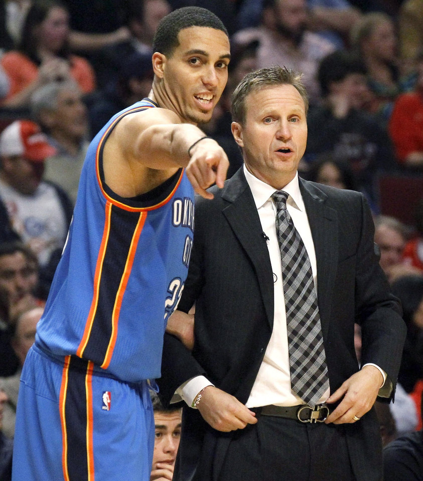 Oklahoma City Thunder shooting guard Kevin Martin, left, talks to head coach Scott Brooks during the second half of an NBA basketball game against the Chicago Bulls, Thursday, Nov. 8, 2012, in Chicago. The Thunder won 97-91. (AP Photo/Charles Rex Arbogast) ORG XMIT: CXA118