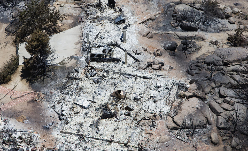 Photo - This aerial photo shows Yarnell, Ariz. on Wednesday, July 3, 2013,  in the aftermath of the Yarnell Hill Fire that claimed the lives of 19 members of an elite firefighting crew on Sunday. The wildfire has burned structures and forced evacuations as hundreds of firefighters work to contain the blaze.  (AP Photo/Tom Tingle)