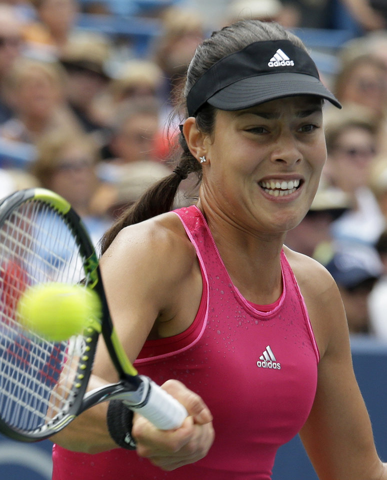 Photo - Ana Ivanovic, from Serbia, hits a forehand against Serena Williams during a final match at the Western & Southern Open tennis tournament, Sunday, Aug. 17, 2014, in Mason, Ohio. Williams won 6-4, 6-1. (AP Photo/Al Behrman)