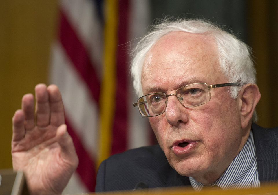 Photo - Senate Veterans Affairs Committee Chairman Sen. Bernie Sanders, I-Vt., speaks on Capitol Hill in Washington, Thursday, May 15, 2014, during the committee's hearing to examine the state of Veterans Affairs health care. (AP Photo/Cliff Owen)