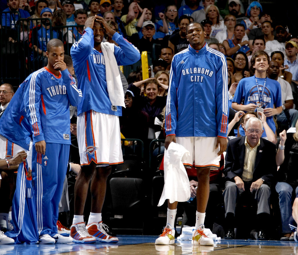 Photo - Oklahoma City's Eric Maynor, left, Serge Ibaka, and Kevin Durant react during the NBA basketball game between the Oklahoma City Thunder and the Milwaukee Bucks at the Oklahoma City Arena, Wednesday, April 13, 2011. Photo by Bryan Terry, The Oklahoman