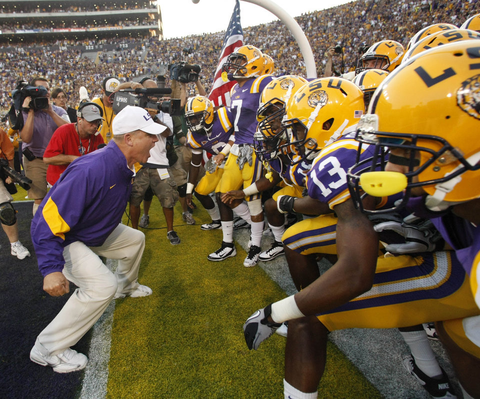 LSU coach Les Miles talks to his player before they took the field for an NCAA college football game against Northwestern State in Baton Rouge, La., Saturday, Sept. 10, 2011. (AP Photo/Gerald Herbert)