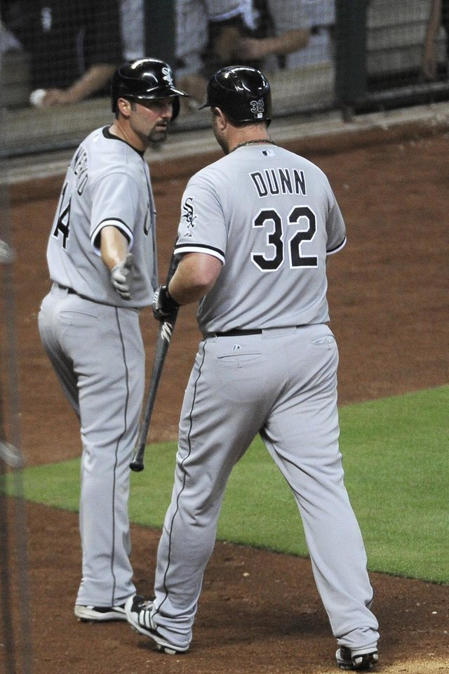 Photo - Chicago White's Sox Paul Konerko (14) congratulates Adam Dunn (32) on his sacrifice fly ball to score Konerko from third base in the fourth inning of a baseball game against the Houston Astros, Friday, June 14, 2013, in Houston. (AP Photo/Pat Sullivan)