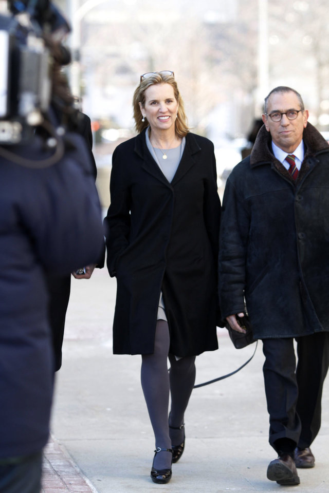 Photo - Kerry Kennedy, center, arrives, Monday, Feb. 24, 2014 at a courthouse for her trial in White Plains, NY.  In 2012, Kennedy, the ex-wife of New York Gov. Andrew Cuomo, was arrested after her car hit a tractor-trailer on an interstate highway near her home outside New York City. She drove to the next exit, where she failed a sobriety test, police said. Blood tests revealed a small amount of the sleeping drug zolpidem. Kennedy claims she accidentally took a sleeping pill instead of her daily thyroid medication. The trial is expected to last a week. (AP Photo/The Journal News, Ricky Flores)
