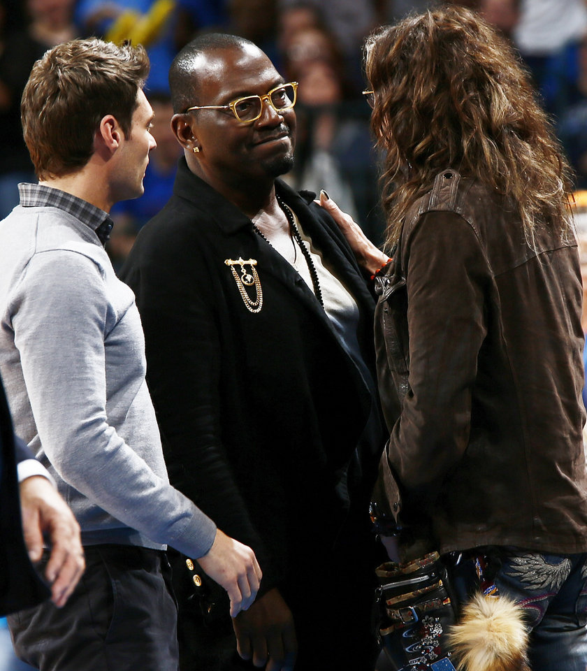 Photo - Steven Tyler, right, talks with Randy Jackson, middle, and Ryan Seacrest during an NBA basketball game between the Detroit Pistons and the Oklahoma City Thunder at the Chesapeake Energy Arena in Oklahoma City, Friday, Nov. 9, 2012. Oklahoma City won, 105-94. Photo by Nate Billings, The Oklahoman