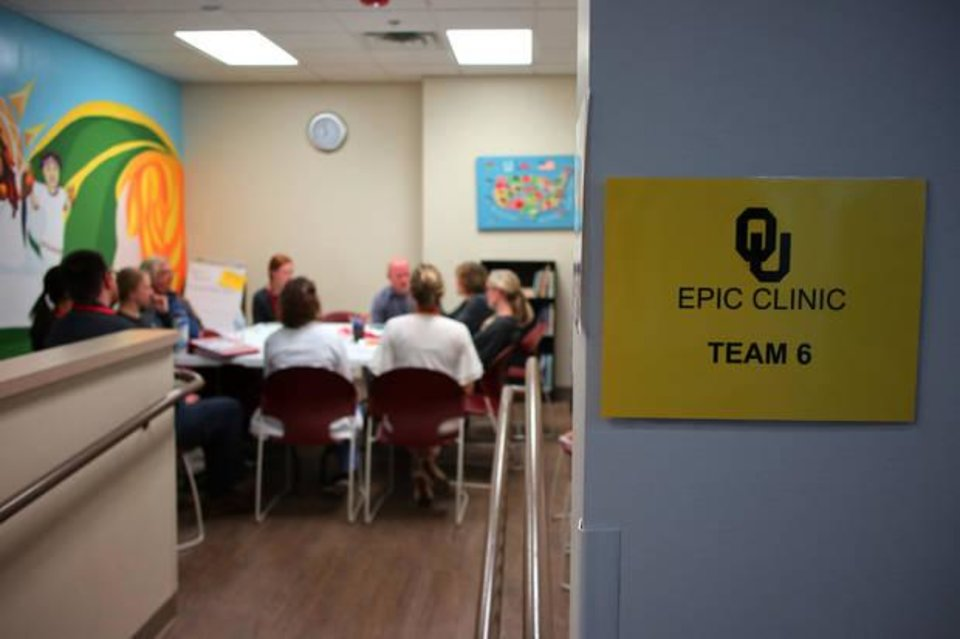 Photo -  University of Oklahoma's Empowering Patients through Interdisciplinary Collaboration team 6 has discussions about clients at Good Shepard clinic. [Photo by Doug Hoke, The Oklahoman]