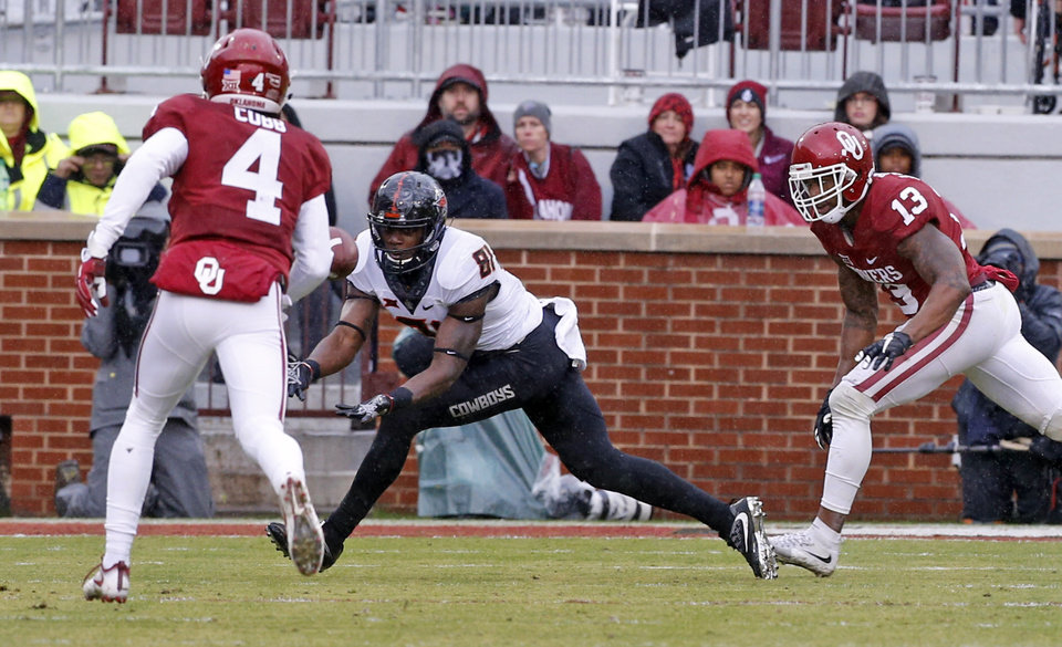 Photo - Oklahoma State's Jhajuan Seales (81) catches a pass near the goal line during the second half of the Bedlam college football game between the Oklahoma Sooners (OU) and the Oklahoma State Cowboys (OSU) at Gaylord Family - Oklahoma Memorial Stadium in Norman, Okla., Saturday, Dec. 3, 2016. Photo by Steve Sisney, The Oklahoman