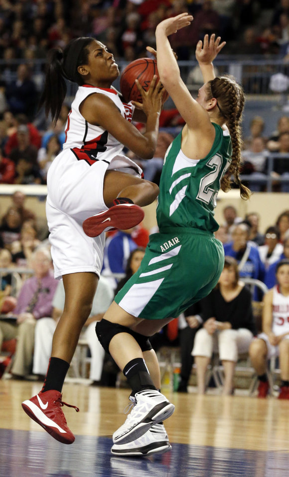 Sulphur's Ebony Harrison shoots over Molly Kerr during the 3A girls semifinal game between the Adair High School Lady Warriors and the Sulphur Lady Bulldogs at the State Fair Arena on Friday, March 8, 2013 in Oklahoma City, Okla.  Photo by Steve Sisney, The Oklahoman