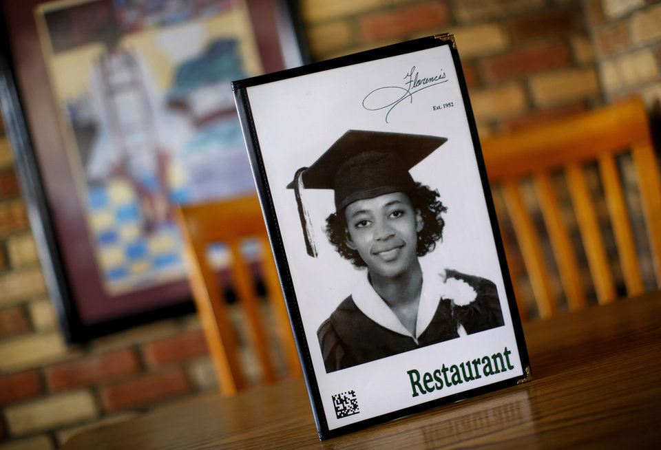 Photo - The menu features a photo of Florence in her youthful years. Florence's Restaurant, which opened in 1952, continues to be owned and operated by Florence Kemp and her daughter. Florence is now in her 80s and still works in the kitchen every day. The restaurant is located in the 1400 block of NE 23.   Photo by Jim Beckel, The Oklahoman