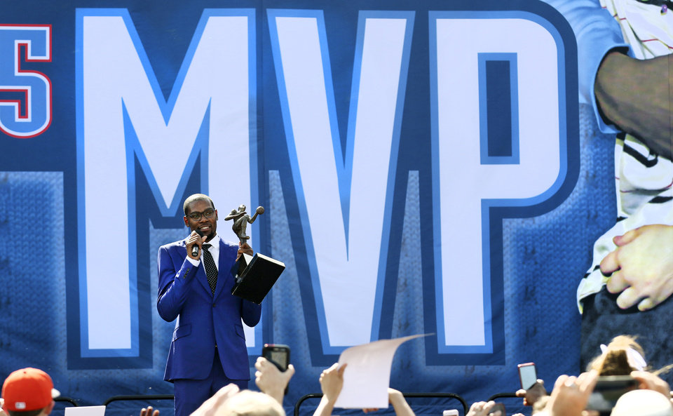 Photo - Kevin Durant holds up his MVP trophy for fans during a rally following the official MVP announcement at the Thunder Community Events Center in Edmond, Tuesday May 06, 2014. Photo By Steve Gooch, The Oklahoman