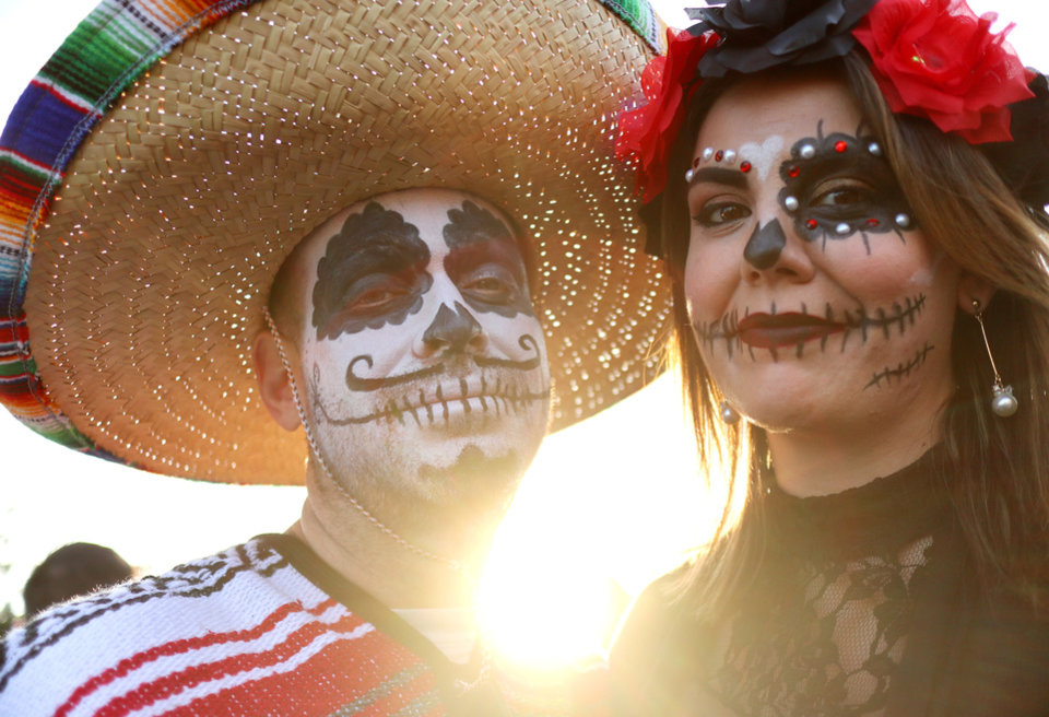 Photo - THE OK Magazine. Chris and Latasha Royal, Bethany, during the Day of the Dead festival in the Plaza District Sunday, November 3, 2019. Photo by Doug Hoke