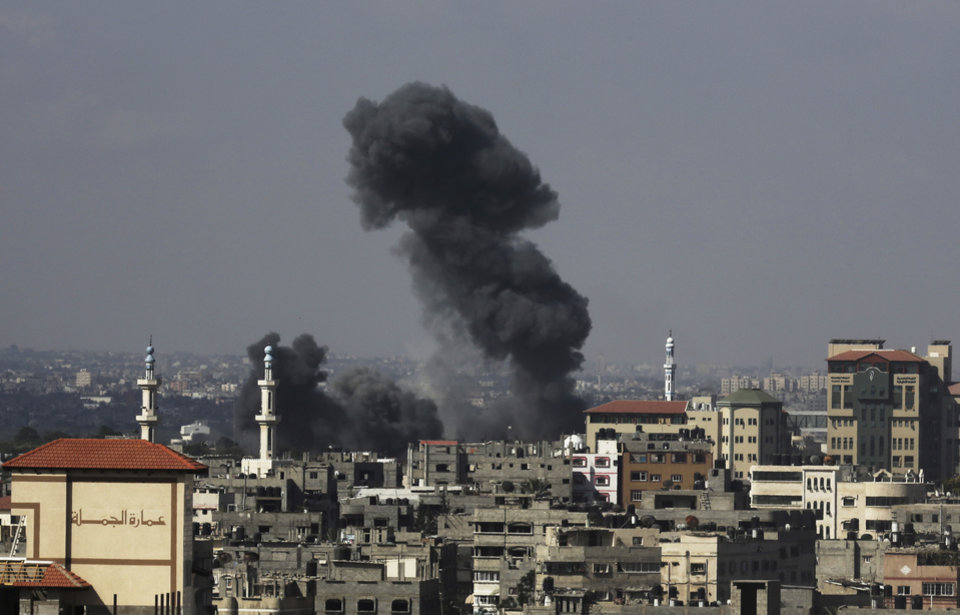 Photo - Smoke rises after Israeli missile strikes hit the northern Gaza Strip, Wednesday, July 16, 2014. A Hamas website says Israel has fired missiles at the homes of four of its senior leaders as it resumed bombardment of Gaza, following a failed Egyptian cease-fire effort. Wednesday's bombings came after Hamas rejected an Egyptian truce proposal on Tuesday and instead launched more rockets at Israel. (AP Photo/Adel Hana)