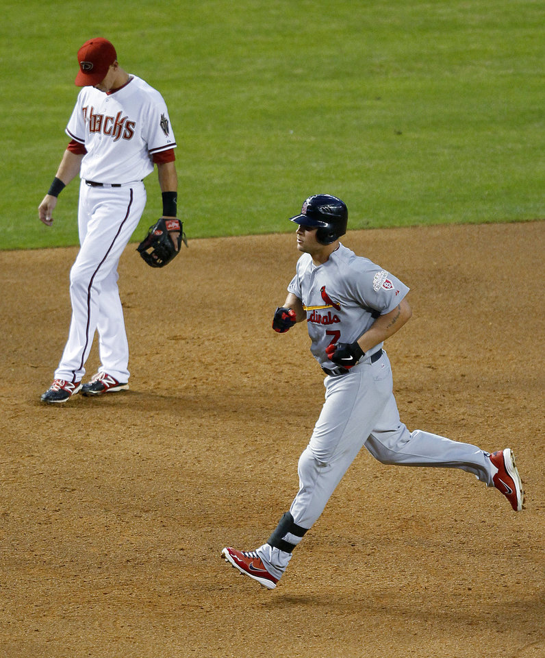 Photo -   St. Louis Cardinals' Matt Holliday rounds the bases after hitting a solo home run, as Arizona Diamondbacks' Cody Ranson kicks the dirt during the third inning of a baseball game Monday, May 7, 2012, in Phoenix. (AP Photo/Matt York)
