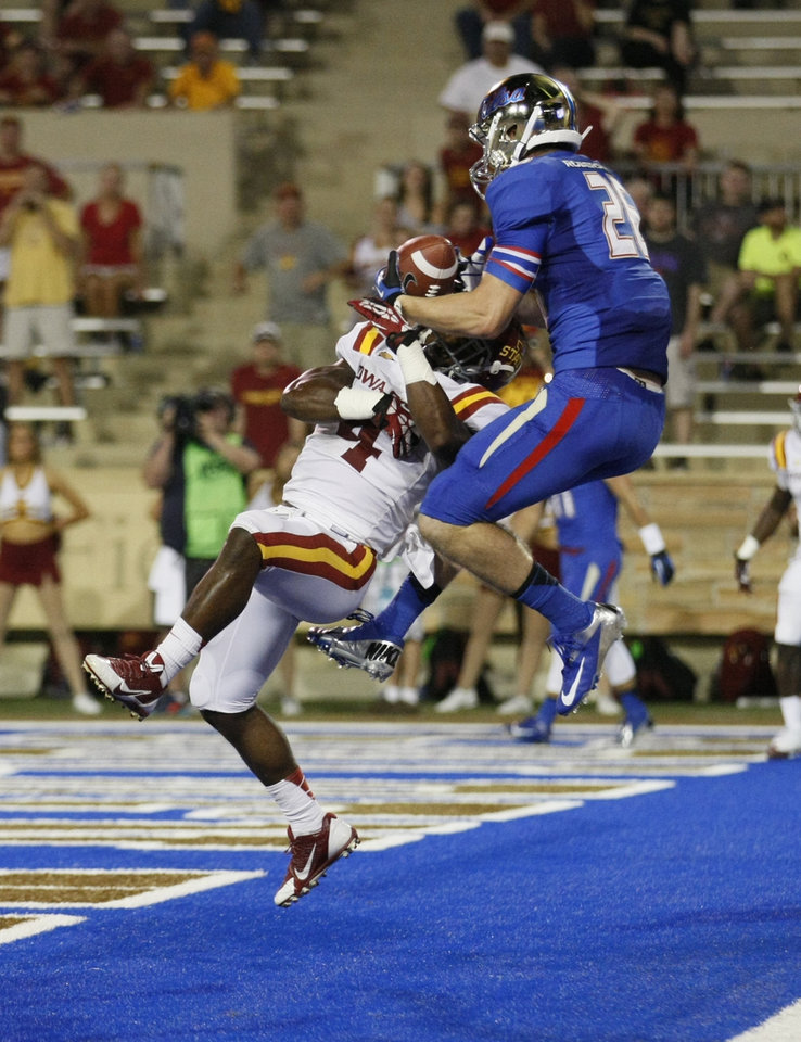 Photo - Tulsa's Thomas Roberson comes down with a  touchdown reception as Iowa State's Sam Richardson tries to defend during the first half of an NCAA college football game, Thursday, Sept. 26, 2013 in Tulsa, Okla. (AP Photo/Tulsa World,  Tom Gilbert)  ONLINE OUT; TV OUT; TULSA OUT